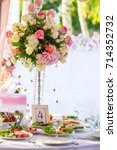 served round banquet table... | Shutterstock . vector #714352732