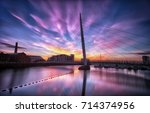 Small photo of Sunrise at the River Tawe and the Millennium bridge in Swansea, South Wales, UK
