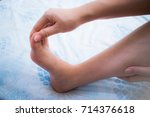 Small photo of Woman has numbness on her right foot. Cramp, Spasm, Twinge, Sprain