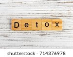 detox word made with wooden... | Shutterstock . vector #714376978