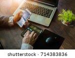 business man hand using... | Shutterstock . vector #714383836