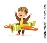 cute little boy in pilot... | Shutterstock .eps vector #714398428