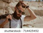 trendy hipster man in... | Shutterstock . vector #714425452