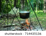 prepearing a meal on an open...   Shutterstock . vector #714435136