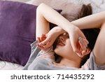 young sleepy head woman waking... | Shutterstock . vector #714435292