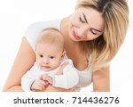 mother and baby playing and... | Shutterstock . vector #714436276