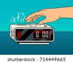 hand turns off the alarm clock...   Shutterstock .eps vector #714449665