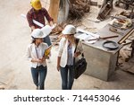 two female  inspectors and... | Shutterstock . vector #714453046