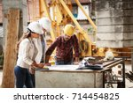 two female  inspectors and... | Shutterstock . vector #714454825