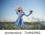 joyful  happy woman with a... | Shutterstock . vector #714462982