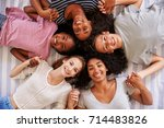 overhead view of teenage... | Shutterstock . vector #714483826