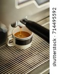 close up small coffee cup under ... | Shutterstock . vector #714495592