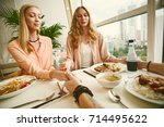 three young person ledies and... | Shutterstock . vector #714495622