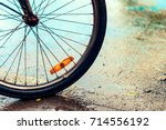 rainy day  closeup old bicycle... | Shutterstock . vector #714556192