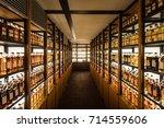 room full of whisky cabinets... | Shutterstock . vector #714559606