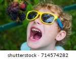 happy laughing boy in the... | Shutterstock . vector #714574282