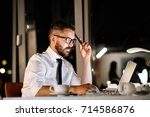 businessman in the office at... | Shutterstock . vector #714586876