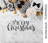 merry christmas card with black ... | Shutterstock . vector #714594022