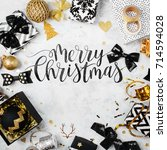 merry christmas card with black ... | Shutterstock . vector #714594028