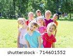 kids outside in park | Shutterstock . vector #714601552