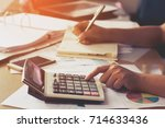 woman hand using calculator and ...   Shutterstock . vector #714633436
