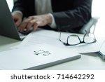 lawyer working in office.... | Shutterstock . vector #714642292
