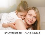 mum and her cute daughter child ... | Shutterstock . vector #714643315