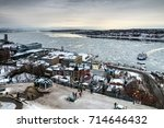 Peaceful morning over Quebec city and the St-Lawrence river, the ferry is carrying passengers from one shore to the other. Quebec, Canada