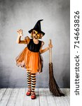 funny child dressed witch... | Shutterstock . vector #714663826