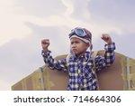 child pretend to be pilot. kid... | Shutterstock . vector #714664306