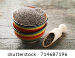 heap of chia seeds in bowl and...   Shutterstock . vector #714687196