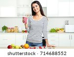 beautiful young woman drinking... | Shutterstock . vector #714688552