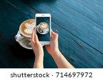 hand holding mobile smart phone ... | Shutterstock . vector #714697972