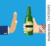 no alcohol. man offers to drink ... | Shutterstock .eps vector #714701092