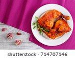 roasted chicken leg quarters... | Shutterstock . vector #714707146