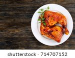 roasted chicken leg quarters... | Shutterstock . vector #714707152