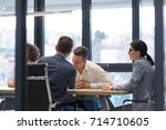 group of a young business... | Shutterstock . vector #714710605