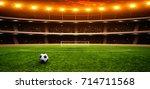 soccer ball on green stadium ... | Shutterstock . vector #714711568