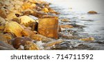 the sea in the autumn at sunset ... | Shutterstock . vector #714711592