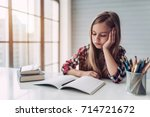 little cute girl is bored and... | Shutterstock . vector #714721672
