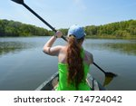 girl kayaking | Shutterstock . vector #714724042