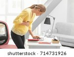 young pregnant woman working in ... | Shutterstock . vector #714731926