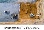 aerial photo of an excavator... | Shutterstock . vector #714736072