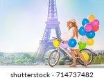 Girl Cycling Through Paris Wit...