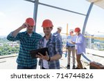 builders on site working with... | Shutterstock . vector #714744826