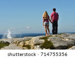 Man And Woman Watching Ocean...