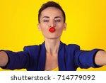 blowing a kiss  selfie shot.... | Shutterstock . vector #714779092