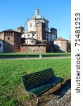 St. Lorenzo church and basilica park with bench, Milan, Lombardy, Italy - stock photo