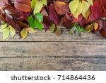autumn background with leaves... | Shutterstock . vector #714864436
