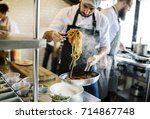 chef cooking spaghetti in the... | Shutterstock . vector #714867748
